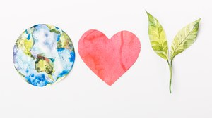 Illustration: Left the earth, in the middle a heart and right two leaves.